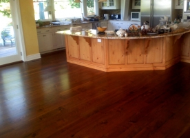 Wide plank pine install with custom stain by First Class Wood Flooring
