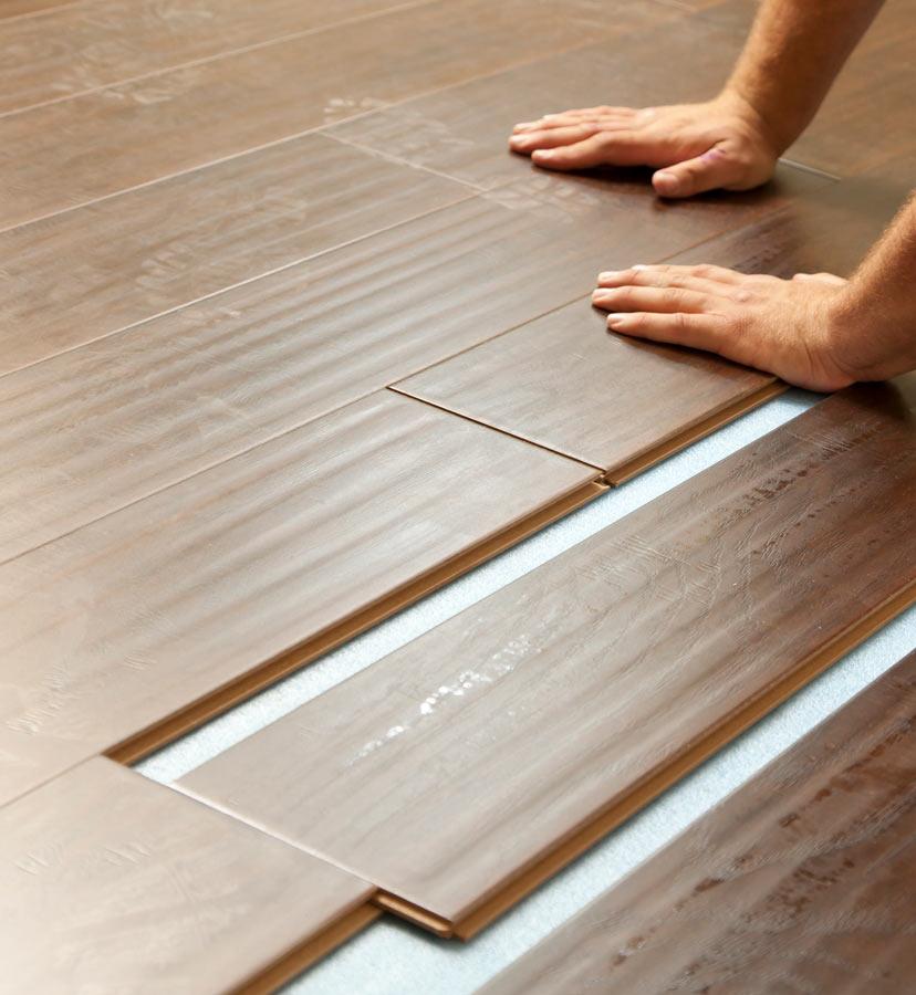 waterproof vinyl plank basement flooring in Stony Brook, NY being installed